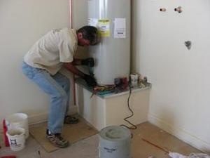 one of our Anaheim water heater repair techs is doing a maintenace check on a heater unit